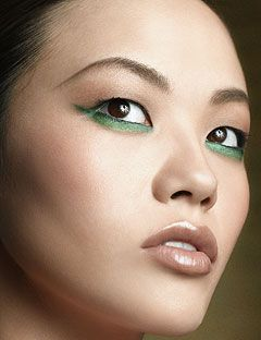 model with green eyeliner under her eyes