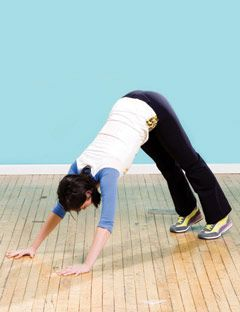 girl in downward facing dog position