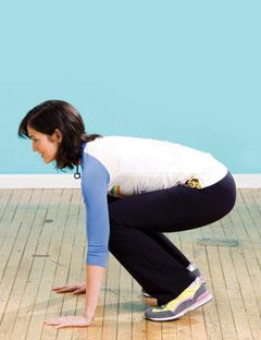 girl squatting with arms on ground