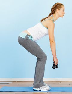 girl in squat position with arms straight down