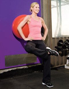 girl doing a one leg squat using an exercise ball