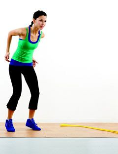 girl in workout clothes preparing to jump