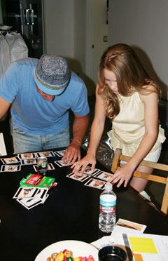 Emily and the photographer, Ian White, looked through Polaroids to get an idea of that the photos would look like.