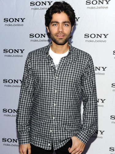 adrian grenier in a dark plaid shirt