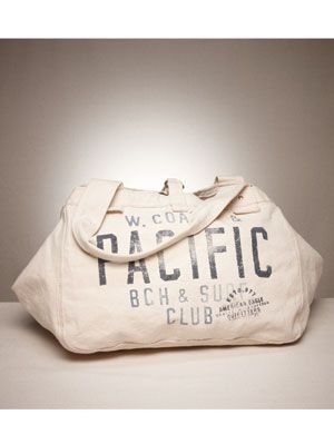 white canvas gym bag with text on the front from american eagle