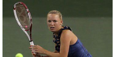 Caroline Wozniacki on the tennis court