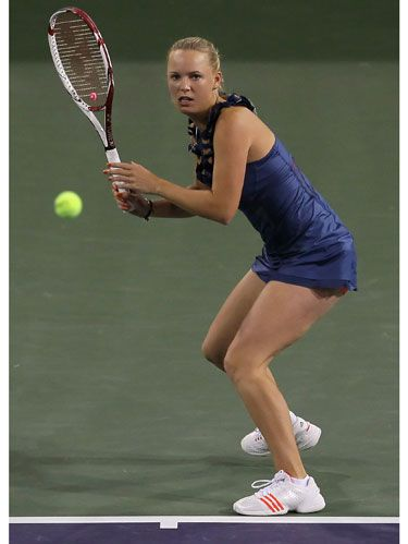Caroline Wozniacki on the tennis court