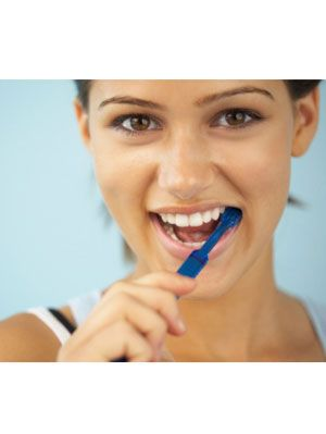 girl smiling with toothbrush in her mouth