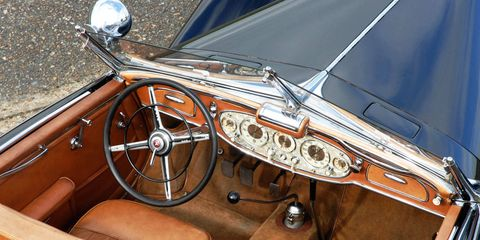 Motor vehicle, Steering part, Mode of transport, Steering wheel, Classic car, Vehicle door, Car, Classic, Personal luxury car, Car seat,