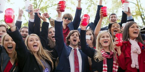 Tailgaters raise a toast to their Rebels at the Grove.