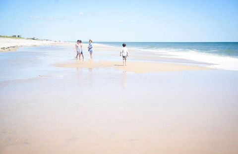 Body of water, Coastal and oceanic landforms, Natural environment, Shore, Coast, Sand, People on beach, Ocean, Fluid, Summer,