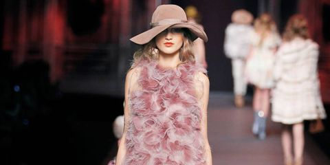 Flowers and fantastical creatures are favorite subjects of Dior's Victoire de Castellane, who has made necklaces out of an opal shaped like a sea urchin and roses from pink quartz, a match for this season's organza cocktail dress.