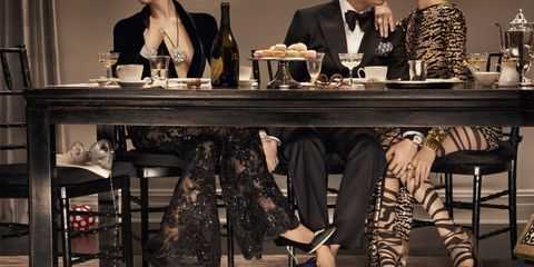 The table had long been cleared, but drinks and desserts lingered a bit longer than they should, as did certain pairs of hands.From left: Zuhair Murad Haute Couture blazer and lace trousers (price on request); Manolo Blahnik shoes ($595); Stephen Russell diamond clips (on shoes, price on request); Chanel Fine Jewelry diamond brooch (worn as necklace, $277,000) and watch ($308,200); Harry Winston Mrs. Winston 62-carat diamond bracelet set in platinum, (price on request); De Beers ring (price on request).The Middle Man: Trying to please everyone was his greatest weakness. Tom Ford tuxedo ($4,940), shoes (1,390), pocket square ($145), and bow tie ($190); Prada shirt ($510); Parmigiani Fleurier Toric oval watch with telescopic hands in rose gold ($95,000).Wild Card: Her choice in hosiery shocked no one. DSquared2 dress ($8,485); Gucci shoes ($1,350); Wolford hosiery ($65); David Yurman starburst ring ($7,800) and yellow citrine cocktail ring ($8,900); David Webb 18K hammered gold cuffs (from $32,500).