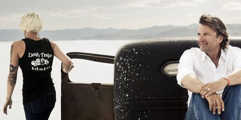 Architect Tom Kundig on the back of a 1937 Chevy pickup restored by Montana-based artist Evelyn Tracey (far left) and her fiancé Devin Bush, at SpeedWeek on the Bonneville Salt Flats.