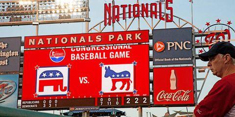 Cap, Sunglasses, Logo, Baseball cap, Advertising, Signage, Display device, Banner, Stadium, Billboard,