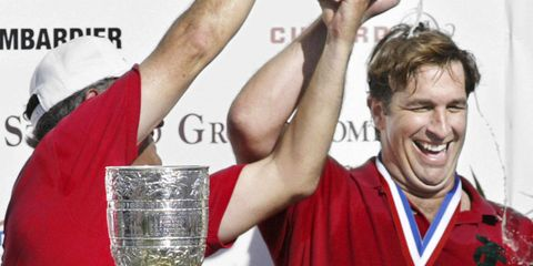 Goodman getting doused in Veuve Cliquot after his Isla Carroll polo team won the U.S. Open at IPC in 2004.