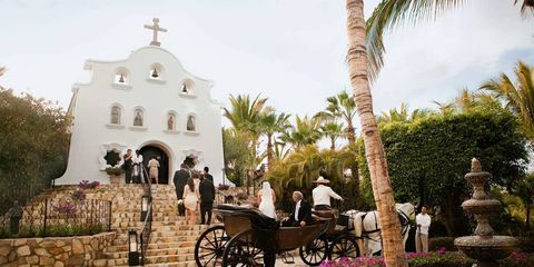 Steal away to Cabo for a beach wedding on the Baja Peninsula, beloved vacation spot of such Hollywood legends as John Wayne and Lucille Ball.THE CEREMONY: Reserve six to eight months in advance; the chapel can accommodate 40 guests inside and 150 more outside.THE RECEPTION: Venues include the resort's outdoor pool deck (up to 250 guests) and the ballroom, with stage (150). THE ACCOMMODATIONS: A one-bedroom suite is the most popular option for the bride to be, as there's ample space to get ready. Guests can stay in the remaining 172 rooms.THE FINE PRINT: The hotel provides all food and beverages, and must sign off on outside vendors, such as photographers and DJs. You'll also need to make your own arrangements (such as a trip to City Hall) to ensure that the marriage is legal in the U.S.THE PERKS: Your very own horse-drawn carriage and footman, and a custom fireworks display.THE DOWNTIME: Snorkeling in the Sea of Cortez.FUN FACT: The hotel can arrange a native Mexican wedding ritual — including a shaman — signifying the longevity of love.Pictured: At the One&Only Palmilla, brides arrive in horse-drawn carriages.palmilla.oneandonlyresorts.com