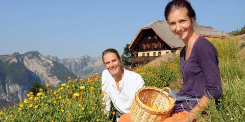 """Jardin des Monts, available at the Palace Spa at the Gstaad Palace Hotel, is a new organic skincare line from Charlotte Landolt and Laetitia Jacot, two horticulturists who set out in 2006 to restore the fields surrounding a 19th-century chalet. Today the pair make use of more than 30 skin-enhancing local botanicals, all carefully tended by a flock of goats to help keep the pastureland from getting overgrown. Once mature, they're hand-picked, dried, and delicately stored in paper bags to preserve their nutrients. The popular Edelweiss Lip Balm is made with a mountain flower known as the """"star of the Alps"""" because of its shape and brilliant white color; its extracts protect lips from UV exposure.jardindesmonts.ch"""