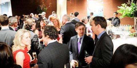 Event, Coat, Suit, Formal wear, Tie, Wine glass, Drink, Conversation, Houseplant, Function hall,