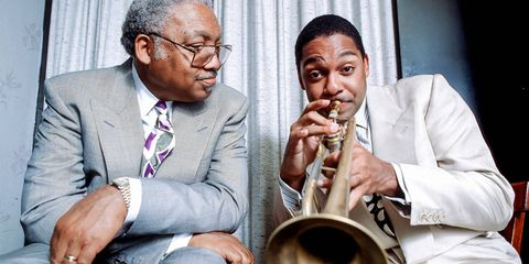 Jazz is their business, and they've monopolized it. Pianist Ellis Jr. — son of Ellis Sr., a civil rights activist — confines his efforts mostly to teaching in his native New Orleans, but his four musical children (out of six) barnstorm far and wide. Wynton (trumpet) is artistic and managing director of Jazz at Lincoln Center and a fixture on PBS and NPR; Branford (saxophone) is a former Tonight Show bandleader; Delfeayo (trombone) produces records; and Jason (drums and vibes) is a respected sideman. Wynton supports Music for Tomorrow, while Branford promotes the Robin Hood foundation and started the Musicians' Village — part of the New Orleans Area Habitat for Humanity's post-Katrina efforts — with fellow musician and New Orleans native Harry Connick Jr. Together the family received a 2011 National Endowment for the Arts Jazz Masters Award.Ellis Marsalis Jr. with son Wynton, backstage at the Blue Note jazz club in New York City, 1990.