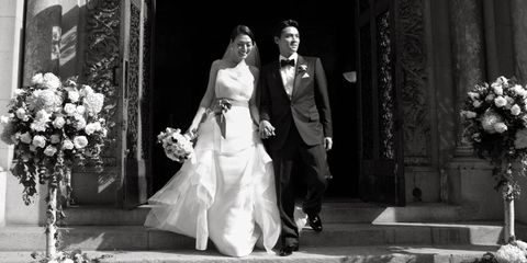 Amanda & Warren leave St. Bart's church after the ceremony.