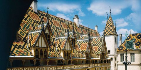 In 1443, near the end of the Hundred Years War (actually, 106 years into it at that point), the chancellor of Beaune, under Philippe the Good, founded a hospital for unfortunates and started a religious order to tend to the sick. Since this hospital sat at the crossroads of a wine producing region, it wasn't long before the sisters healed a few local vintners who, in gratitude for their return to health, handed over hunks of their vineyards.Soon the Hospice had sizable holdings checkering the hillsides of Burgundy and sales of the wine production on these deeded lands helped subsidize hospital operations. By 1859, the sales were formalized into an annual auction, mostly for wine traders, who bought by the barrel and sold by the bottle.