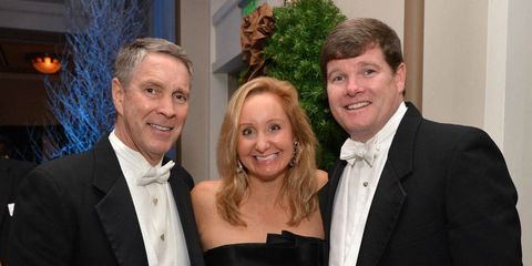"""On Saturday evening Nashville Symphony supporters gathered at the Schermerhorn Symphony Center for the 29th annual Symphony Ball, which raises money for the institution's music and educational programs. Co-chairs Jane Anne Pilkinton and Jennifer Puryear welcomed over 400 guests and attendees included Senator Bill Frist (above, with Mary Lauren and Lawson Allen), Martha Ingram, Judge Gil Merritt, Mr. and Mrs. Robert Patton, along with Kimberly McDonald (2013 Jewelry Partner)and three-time Grammy Award winner and Nashvillian Brad Paisley. In true southern style, guests at the white-tie affair were greeted with champagne and whiskey cocktails.    Each year the Nashville Symphony presents the Harmony Award to an individual who exemplifies the harmonious spirit of Nashville's thriving musical community. This year, Senator Robert Frist presented the award to his """"longtime friend,"""" country music legend Brad Paisley. Paisley followed his acceptance speech with a heartfelt performance alongside the Symphony. Guests danced into the wee hours. Since 1985, the Symphony Ball has raised more than $6.5 million."""
