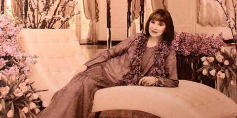 Comfort, Sitting, Twig, Petal, Long hair, Photo shoot, Bouquet, Vintage clothing, Floral design, Portrait photography,