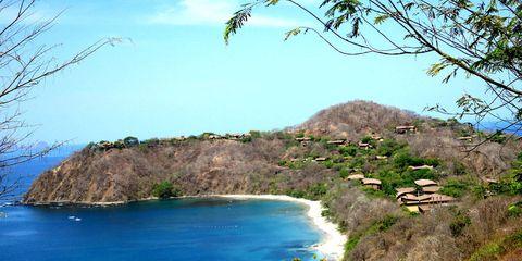 Body of water, Vegetation, Nature, Coastal and oceanic landforms, Coast, Natural landscape, Landscape, Bay, Hill, Azure,