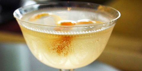 """This name of this cocktail, available at the Fairmont Pacific Rim in Vancouver, translates from French as """"to give in,"""" and we suggest doing just that with it. Here's the recipe: 30ml Lillet Blanc15ml Giffard Creme de Peche3 dashes Orange Bitters60ml Sparkling Mineral WaterCombine all ingredients in a mixing glass, stir, and serve in a coupe with an orange peel garnish."""