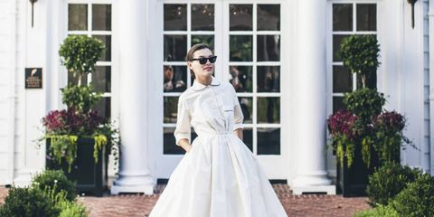 """""""If there ever were a collection that lent itself to our world, this is it,"""" says Laura Vinroot Poole, proprietor of Charlotte, North Carolina's chicest shop Capitol. She's referring to Giambattista Valli's unbelievably stunning Fall 2014 couture collection. """"It felt so Southern to me,"""" she says. """"From the wisteria-printed mousseline and gardenia embroidered lace to the layers of tulle, gorgeous colors and unabashed femininity."""" This past Tuesday Poole brought the collection to her neck of the woods and presented it at the Duke Mansion. """"Doris Duke's childhood home was built in 1915 and still has almost all of the original details, like sleeping porches, rose gardens, fountains, and a portrait of Mrs. Duke as a young girl in the foyer."""" The historical setting prompted her to further the glamour with a retro-style runway show. """"We were very inspired by couture shows by Christian Dior, Balenciaga, and Charles James from the 1950s,"""" she says. """"We tried to create that feeling with this show, instead of a traditional runway show. The clothes really came alive in this setting and there were audible jaws dropping when many of the looks entered the room."""" Equally as crafted as the couture pieces was the event itself. Every detail was carried out with elegance—from the invitations and program notes that were hand-engraved by Arzberger Engravers to the menu that included homemade tomato sandwiches with tomatoes from Poole's garden."""