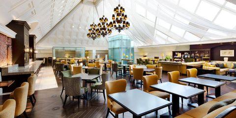 Interior design, Room, Ceiling, Table, Furniture, Light fixture, Hall, Chair, Interior design, Chandelier,