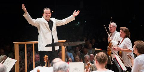 <p>Conductor Andris Nelsons leads the Boston Symphony Orchestra at Tanglewood.</p>