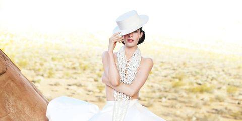 Hat, Dress, Textile, Photograph, Sitting, Fashion accessory, Wedding dress, Beauty, Gown, Embellishment,