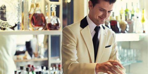 Dress shirt, Collar, Coat, Outerwear, Suit, Formal wear, Alcohol, Barware, Bottle, Blazer,
