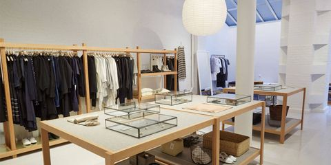 Table, Interior design, Clothes hanger, Light fixture, Shelving, Collection, Plywood, Shelf, Outlet store,