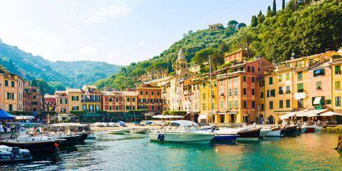 Watercraft, Town, Mountainous landforms, Water, Boat, Waterway, Building, Hill, Harbor, Mountain range,