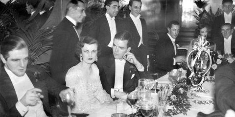Photograph, Stemware, Tablecloth, Suit, Tableware, Formal wear, Table, Drinkware, Champagne stemware, Tie,