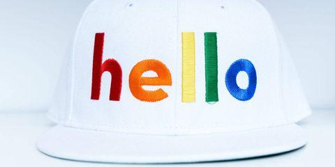 Text, White, Cap, Headgear, Costume accessory, Logo, Azure, Circle, Baseball cap, Cricket cap,