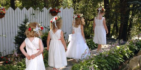 Dress, Petal, Bridal clothing, Child, Wedding dress, Tradition, Ceremony, Gown, Garden, Hair accessory,
