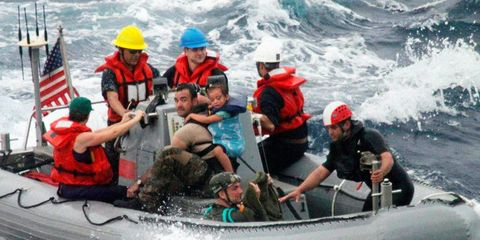 Inflatable boat, Fun, People, Recreation, Social group, Personal protective equipment, Water, Watercraft, Flag, Boat,