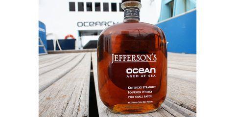 Fluid, Liquid, Bottle, Orange, Amber, Font, Drink, Distilled beverage, Glass bottle, Whisky,