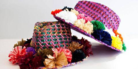 Purple, Costume accessory, Dessert, Sweetness, Hair accessory, Artificial flower, Cut flowers, Floral design, Baked goods, Flower Arranging,