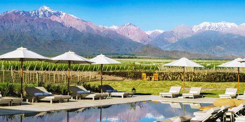 Swimming pool, Mountainous landforms, Mountain range, Resort, Sunlounger, Outdoor furniture, Mountain, Ridge, Summit, Shade,