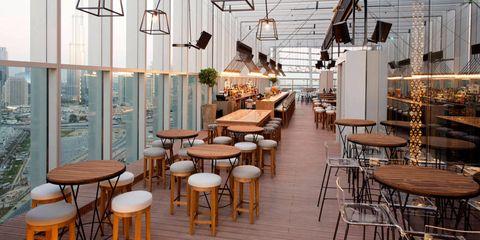 Furniture, Interior design, Hardwood, Restaurant, Wood stain, Light fixture, Electricity, Cafeteria, Design, Hall,