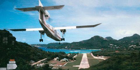 Airplane, Road, Aircraft, Sky, Infrastructure, Road surface, Propeller-driven aircraft, Aviation, Propeller, Asphalt,