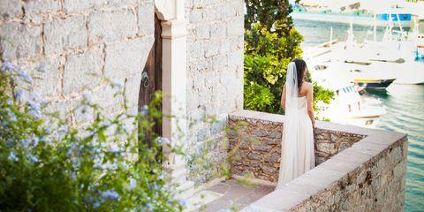 Dress, Watercraft, Bridal clothing, Bride, Wedding dress, Shrub, Groundcover, Gown, Ceremony, Bridal party dress,