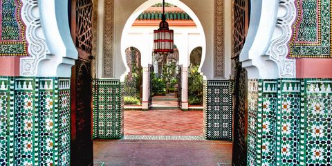 Green, Pattern, Majorelle blue, Teal, Arch, Turquoise, Symmetry, Visual arts, Arcade, Historic site,