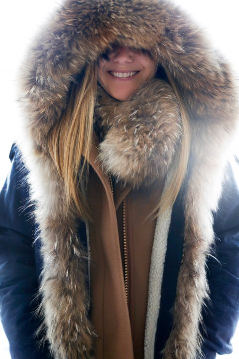 Clothing, Jacket, Brown, Winter, Skin, Fur clothing, Textile, Outerwear, Natural material, Facial expression,