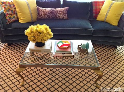 """<p>""""I like a balance of books and objects on my two-tone metal table. A coffee table needs to be pretty, but it should also say a little something about you."""" &#151;<em>Barrie Benson</em></p>"""